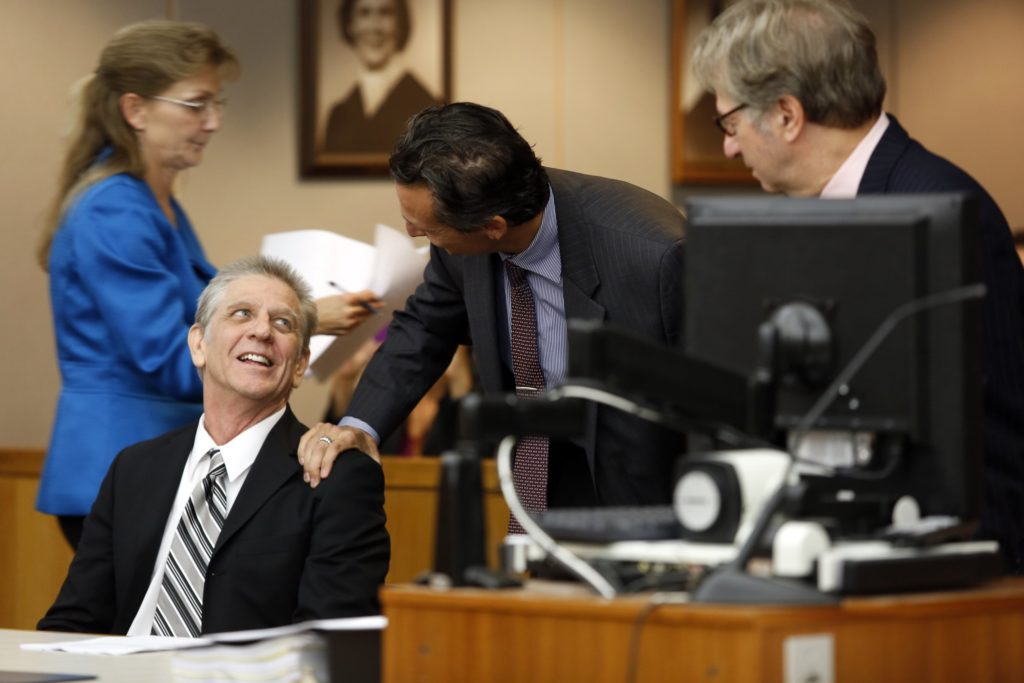 Steven Mark Chaney and Innocence Project Attorneys M. Chris Fabricant (center) and Barry Cshack (right) during a hearing in a Dallas courtroom where a court reversed his 1987 murder conviction because of discredited bite mark testimony.Photographed on Monday, October 12, 2015. (Photo copyright Lara Solt)
