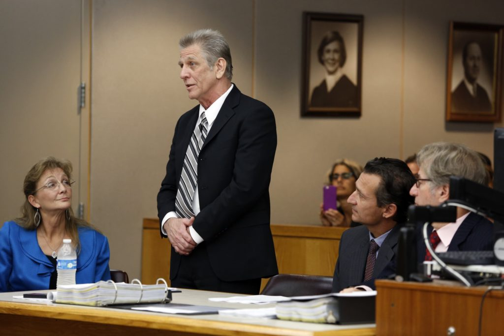 Steven Mark Chaney addresses the court during a hearing in a Dallas courtroom where a court reversed his 1987 murder conviction because of discredited bite mark testimony.Photographed on Monday, October 12, 2015. Innocence Project Attorneys M. Chris Fabricant and Barry Cshack are on the right and Dallas Public Defenders Exoneration Attorney Julie Lesser is on the left. (Photo copyright Lara Solt)