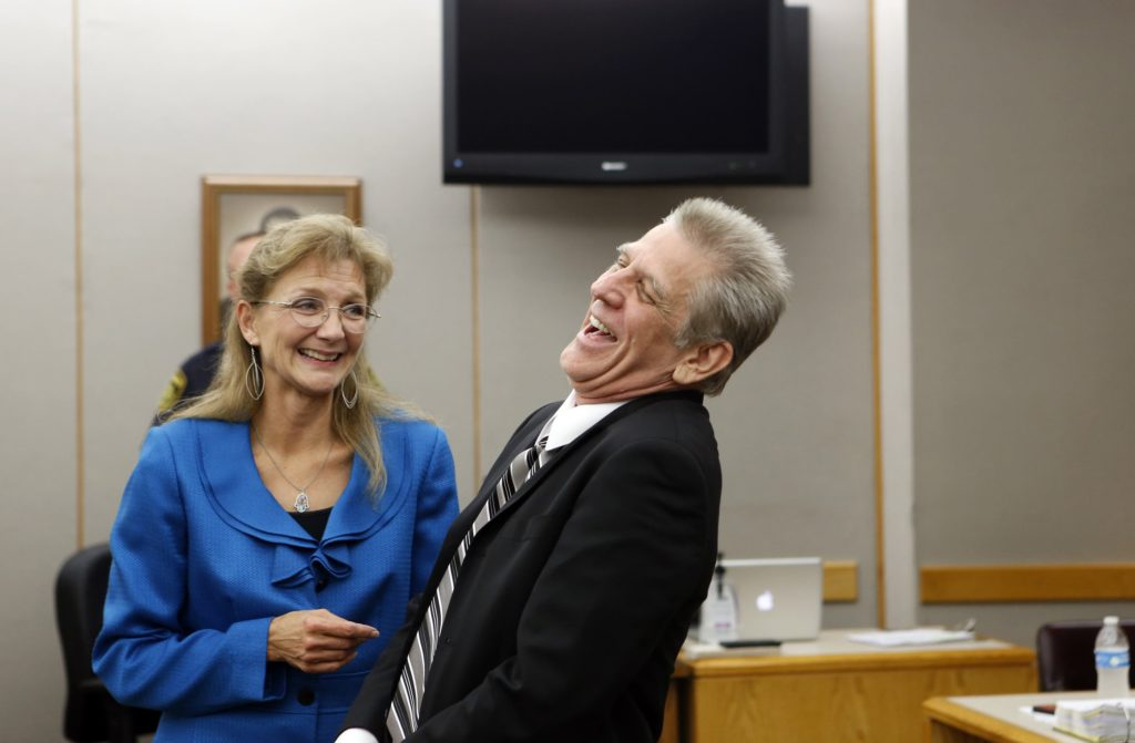 Steven Mark Chaney reacts to his release during a hearing in a Dallas courtroom where a court reversed his 1987 murder conviction because of discredited bite mark testimony.Photographed on Monday, October 12, 2015. Dallas Public Defenders Exoneration Attorney Julie Lesser is on the left. (Photo copyright Lara Solt)