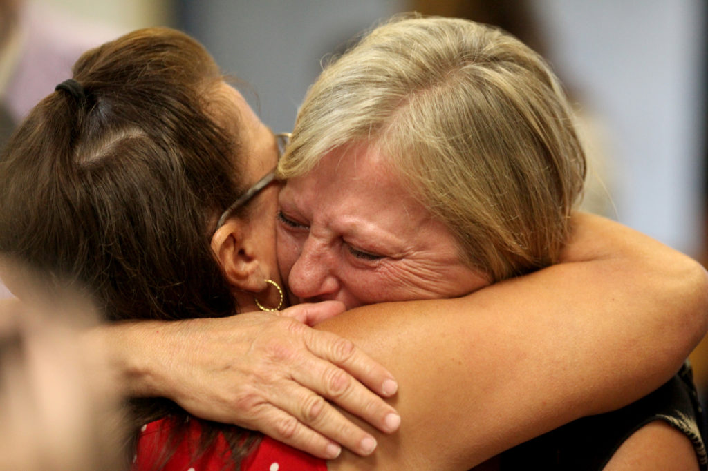 Defendents' families embrace at hearing in summer 2016. Aaron Borton/ Innocence Project