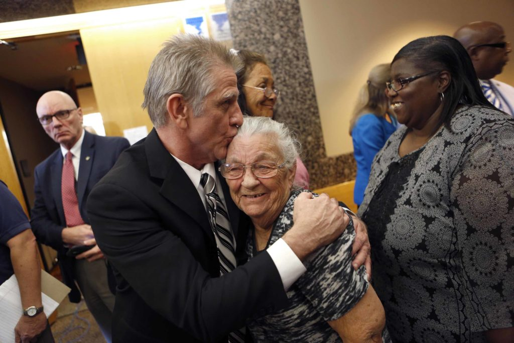 Steven Mark Chaney hugs his mother, Darla Chaney, for the first time in years after walking out of a Dallas courtroom this afternoon after a court reversed his 1987 murder conviction because of discredited bite mark testimony.Photographed on Monday, October 12, 2015. (Photo copyright Lara Solt)