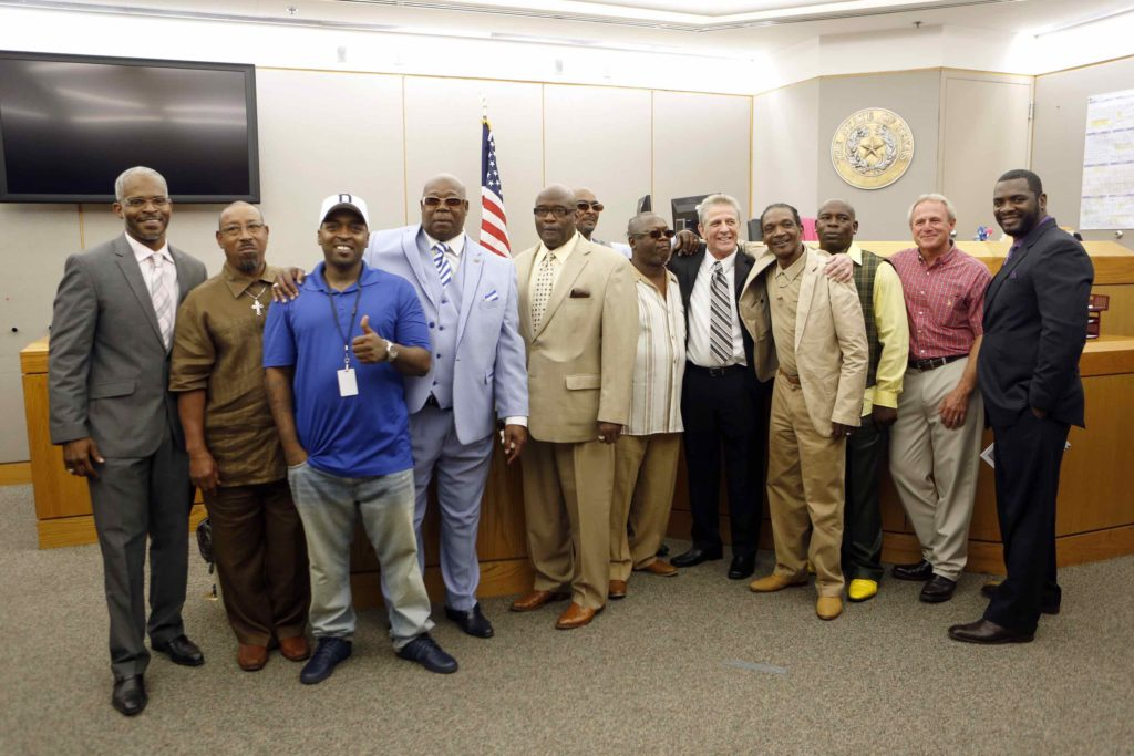 Steven Mark Chaney poses for a picture with other exonerees after a hearing in a Dallas courtroom where a court reversed his 1987 murder conviction because of discredited bite mark testimony.Photographed on Monday, October 12, 2015. (Photo copyright Lara Solt)
